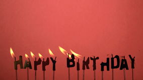 Silhouette of happy birthday candles being extinguished Stock Image
