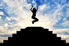 Silhouette of a happy business woman in a jump Stock Images