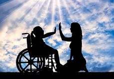 Happy disabled child girl in wheelchair and her mom royalty free stock photography