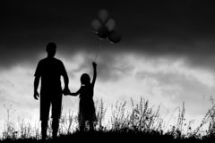 Silhouette of a happy family. With children stock photography