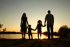 Silhouette of a happy family with children Royalty Free Stock Images