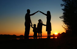 Silhouette of a happy family Stock Photography