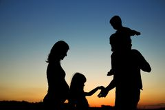 Silhouette of a happy family with children. Silhouette of a happy pregnant family with children stock photo