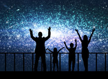 Silhouette of happy family in cosmos Stock Photography
