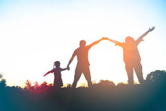 Silhouette of happy family father,mother and daughter Stock Image