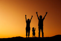 Silhouette of happy family father mother and son playing outdoor Royalty Free Stock Photo