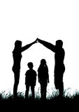 Silhouette of a happy family making the home sign Royalty Free Stock Images