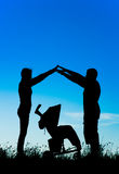 Silhouette of a happy family making the home sign over the pram Royalty Free Stock Images