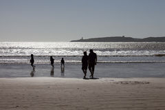 Silhouette of happy family playing on beach. Together at sunset in Essaouira, Morocco stock photos