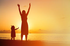 Silhouette of happy mother and little daughter at royalty free stock photography