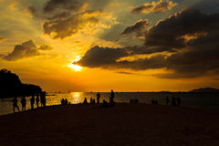 Silhouette of happy people on the beach. At sunset Royalty Free Stock Photos