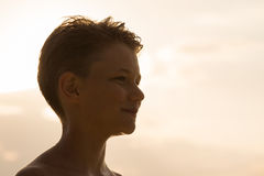 Silhouette happy teenager during sunset. Portrait happy teenager during sunset, close up Royalty Free Stock Photography
