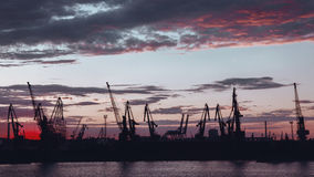 Silhouette of Harbour cranes after sunset Royalty Free Stock Images