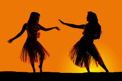 Silhouette of Hawaiian woman grass skirts dancing royalty free stock photo