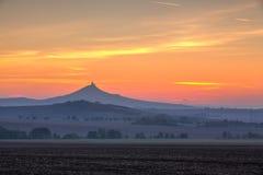 The silhouette of Hazmburk Castle at sunrise.Czech Republic. stock photos