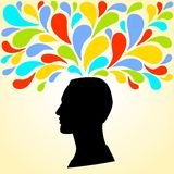 Silhouette of the head of the man thinks bright colorful splashes Stock Photos