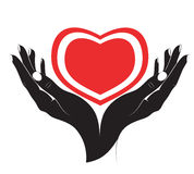 The silhouette of heart in female hands. Royalty Free Stock Image