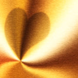 Silhouette of heart on a gold Stock Photo
