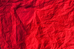 Silhouette of the heart on a red crumpled paper. Background, texture Stock Photos