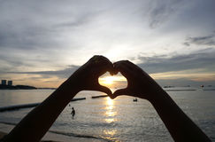 Silhouette heart shape from human hands Royalty Free Stock Photo