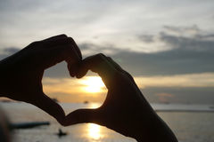 Silhouette heart shape from human hands Royalty Free Stock Images