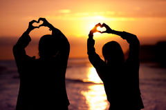 Silhouette heart shape sunset Royalty Free Stock Images