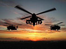 Silhouette of helicopter. Over sunset Royalty Free Stock Images