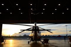 Silhouette of helicopter in the hangar Royalty Free Stock Photo