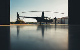 Silhouette of helicopter in the hangar with a pilot Royalty Free Stock Photography