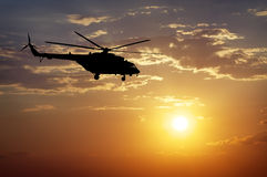 Silhouette of helicopter Stock Photos