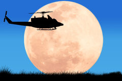 silhouette  of  helicopter on the sky night full moon Royalty Free Stock Image
