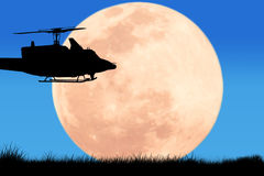 Silhouette  of  helicopter on the sky night full moon Stock Photos