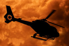 Silhouette of helicopter taking off Royalty Free Stock Photography