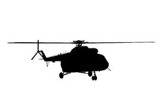 Silhouette of the helicopter. Stock Photo