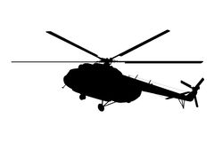 Silhouette of the helicopter. Royalty Free Stock Images
