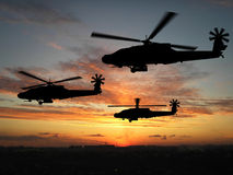 Silhouette of helicopters. Over sunset Royalty Free Stock Image