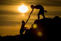Silhouette of  helping hand of a friend Royalty Free Stock Photo