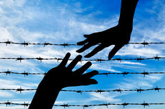 Silhouette helping hand to refugees Stock Images