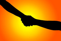 Silhouette of helping hand between two climber Stock Photos