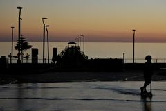 Silhouette of Henley Beach square and pier at dusk in Adelaide South Australia. Silhouette of Henley Beach pier and square at dusk. Henley Beach pier is a very royalty free stock photos