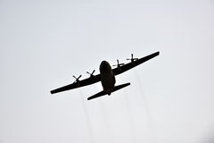Silhouette of hercules transport plane Royalty Free Stock Image
