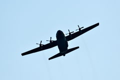 Silhouette of hercules transport plane Stock Photos