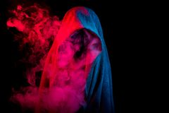 Silhouette hidden by colorful smoke Royalty Free Stock Image