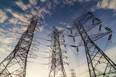 Silhouette of high power transmission towers. Royalty Free Stock Images