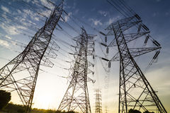 Silhouette of high power transmission towers. Royalty Free Stock Photo