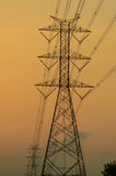 Silhouette of high voltage electric tower. With sunset background Stock Photo