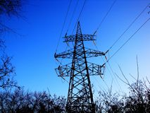 Silhouette High voltage electric tower on sunset time and sky royalty free stock images
