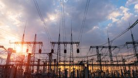 High-voltage power lines at sunset. electricity distribution station. Silhouette High voltage electric tower on sunset time and sky on sunset time background stock photos