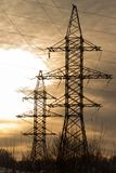 Silhouette High voltage electric tower on sunset time and sky on sunset time background. Silhouette High voltage electric tower on sunset time and sky Stock Photos