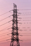 Silhouette of high voltage electric tower. Royalty Free Stock Photos